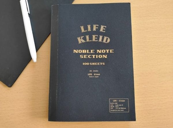 life noble notebook with ballpoint pens and file