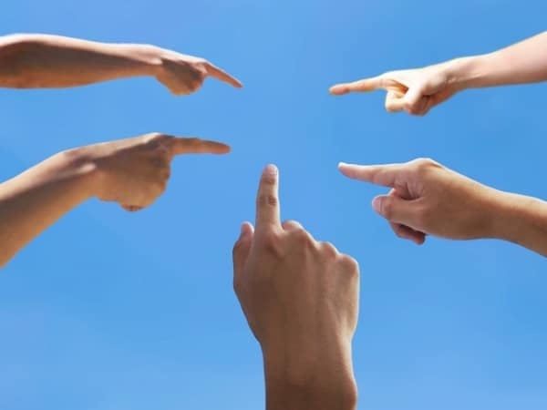 five people pointing their fingers at sth