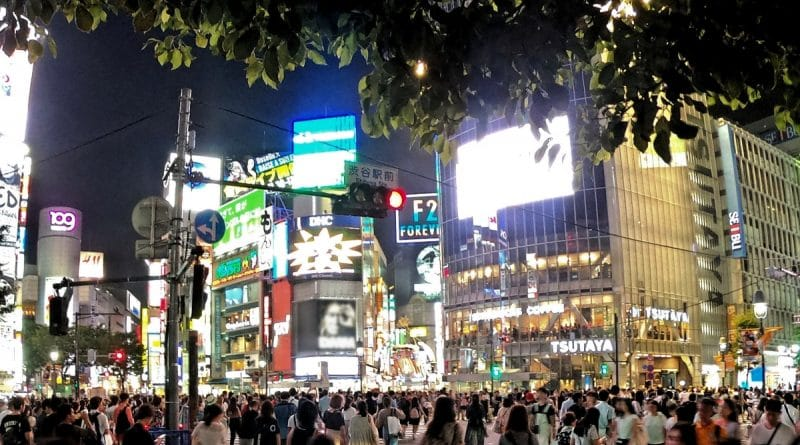 shinjuku city with many pedestrians at night