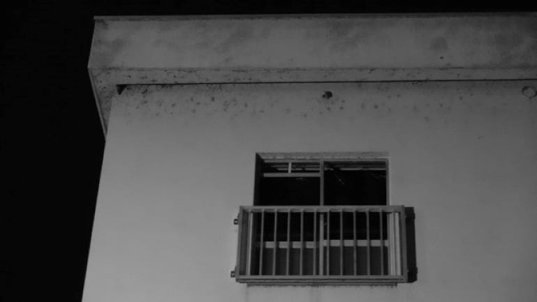 window of a creepy house late at night
