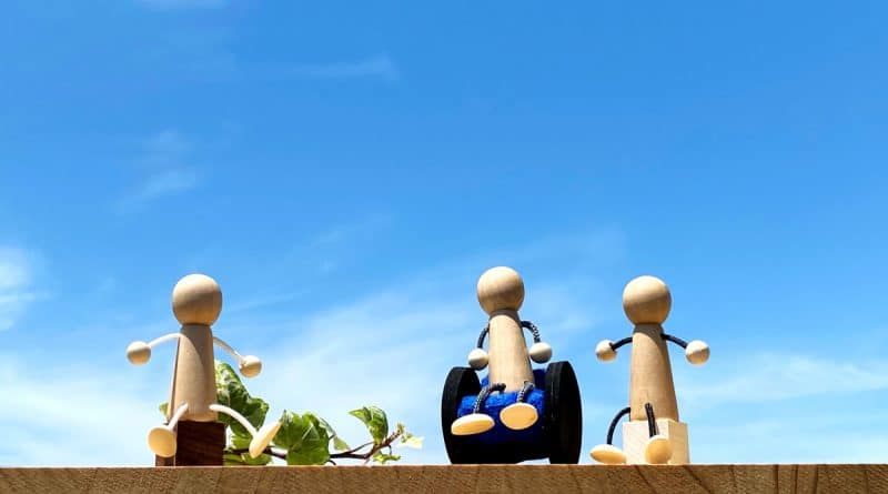 Dolls are communicating under the blue sky