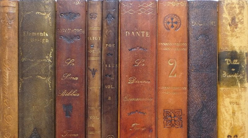 neatly placed old books with mold and stains on them