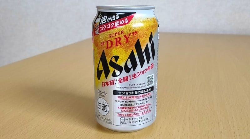 asahi draft beer can on a wooden table