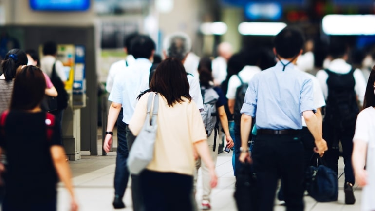 Japanese people walking in the train station