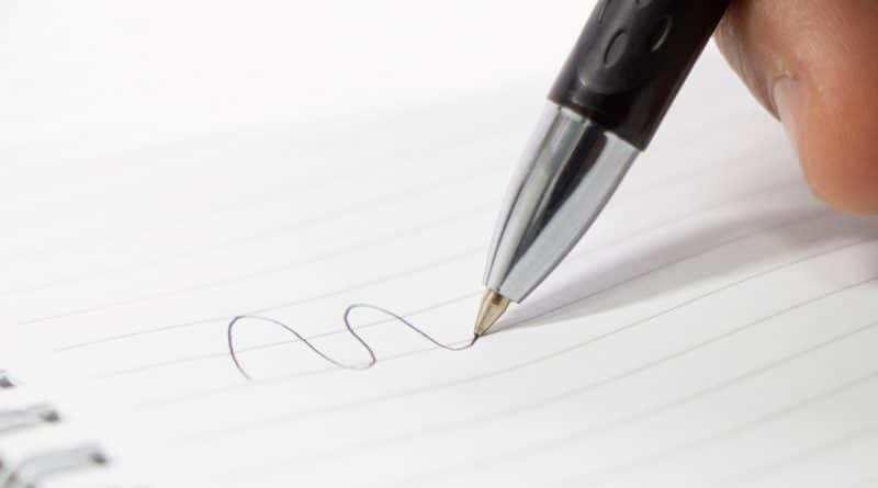 writing with a ballpoint pen on a white paper