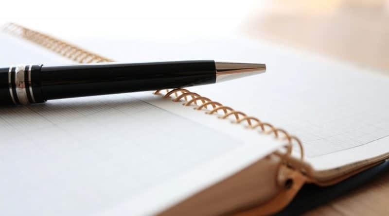 ballpoint pen on a ring notebook